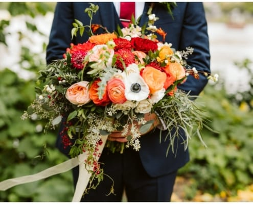 Nicollet Island Pavilion, fall wedding, fall flowers, fall bouquet, fall floral, fall wedding floral, Minnesota wedding, Minnesota fall wedding, Nicollet island Pavilion, navy blue wedding, red flowers, yellow flowers, orange flowers, floral design, floral decor, Minnesota wedding florist, Tessa June Photography, Minneapolis wedding florist, Twin Cities wedding florist, Nicollet Island Pavilion wedding florist, Artemisia Studios