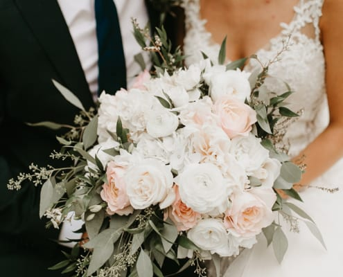 Bloom Lake Barn, Rachel Traxler Photography, barn wedding, Minnesota barn wedding, blue barn, wedding inspiration, summer wedding, blush wedding, rustic wedding, indoor barn wedding, blush bridal bouquet, soft bridal bouquet, Artemisia Studios, Minneapolis wedding florist, Minnesota wedding florist