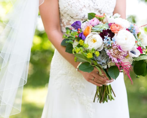 PAIKKA, Callie V Photography, colorful bouquet, colorful flowers, vibrant wedding flowers, black bridesmaids dresses, wedding details, Minneapolis wedding florist, PAIKKA wedding florist, Minnesota wedding florist, Artemisia Studios