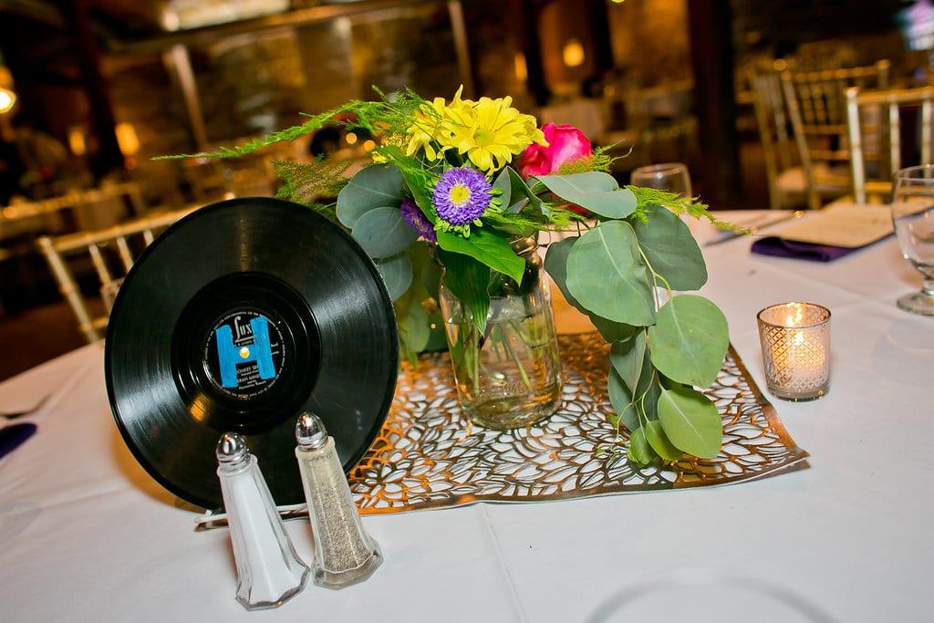 Camelot Photography, Lowertown Event Center, bright wedding floral, colorful wedding floral, sunflower bouquet, colorful bouquet, summer wedding, wedding ideas, bouquet, gerbera daisies, Saint Paul wedding florist, Artemisia Studios