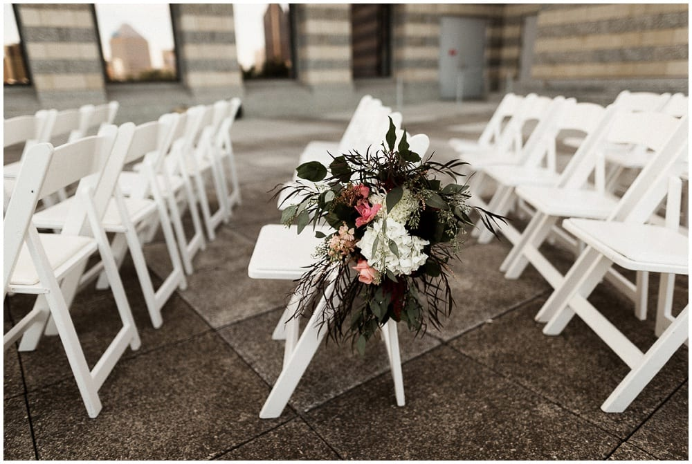 Tandem Tree Photography, Minnesota History Center, wedding, wedding floral, wedding flowers, Minnesota wedding florist, wedding florist, wedding floral arrangements, Minnesota wedding, wedding ceremony, outdoor wedding ceremony, floral decor, wedding decor, ceremony arch, chair swags, aisle decor